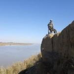 handler & MWD up top river bank
